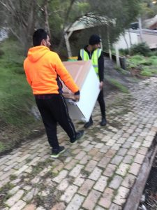 two man moving a furniture